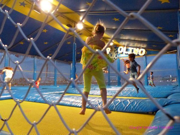 Kids jumping on trampolines at Geneva festival Switzerland