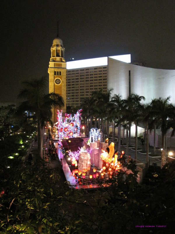 Old Kowloon clock tower with festive decor in foreground