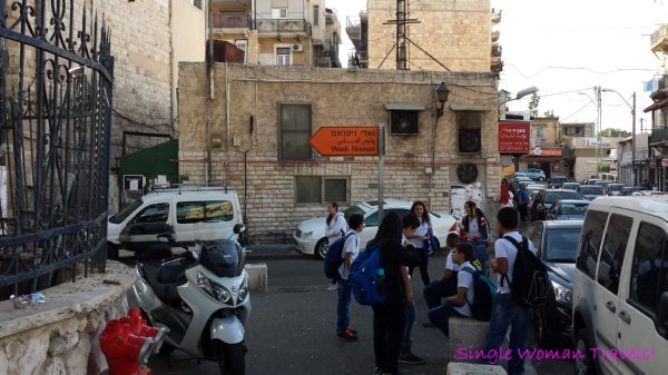 Signage directing to Wadi Nisnas in Haifa Israel