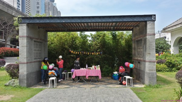 Imported workers in Hong Kong setting up for a birthday party at local park