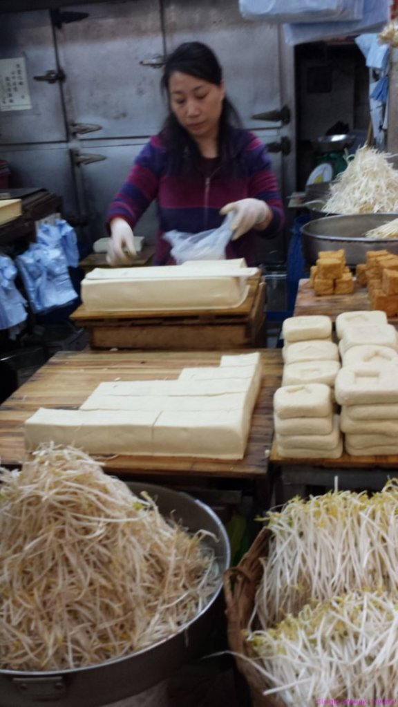 Tofu vendor inside fresh market in Hong Kong