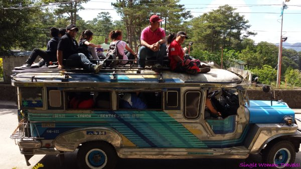 Jeepney between Bontoc and Sagada with roof riders in Philippines