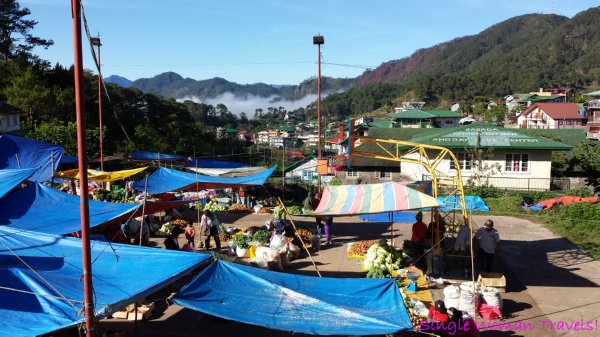 Tarps protect vendors from the at the Saturday market in Sagada Philippines